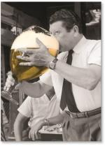 Man drinking large glass of beer