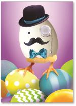 Dapper chick atop Easter eggs.
