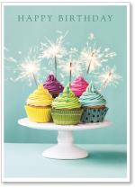 Cupcakes on plate with sparklers