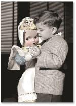 Boy dancing with doll