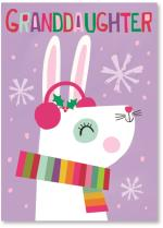 White bunny wearing scarf and earmuffs